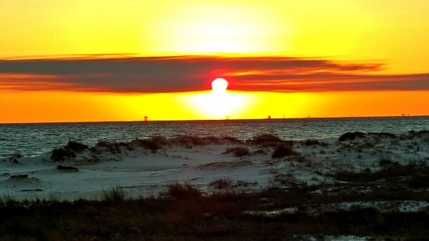 Making the most out of 24 hours in Gulf Shores, Alabama includes watching the stellar sunsets.