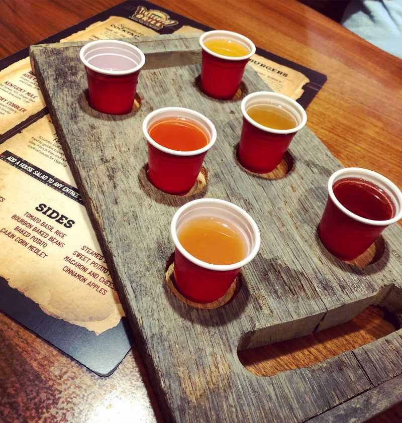 One of 10 things for Millennials to do in Pigeon Forge is sample a flight of moonshine at the Timberwood Grill.